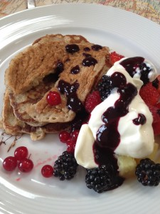Oat pancakes with summer fruit, blueberry coulis and greek yoghurt