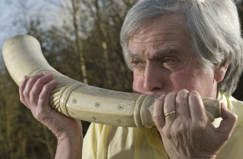Bill Hart plays a ceremonial horn